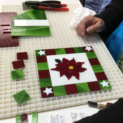Fused christmas cookie tray class student assembling poinsettia project
