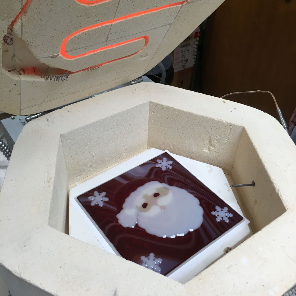 Fused santa cookie tray in kiln being fired