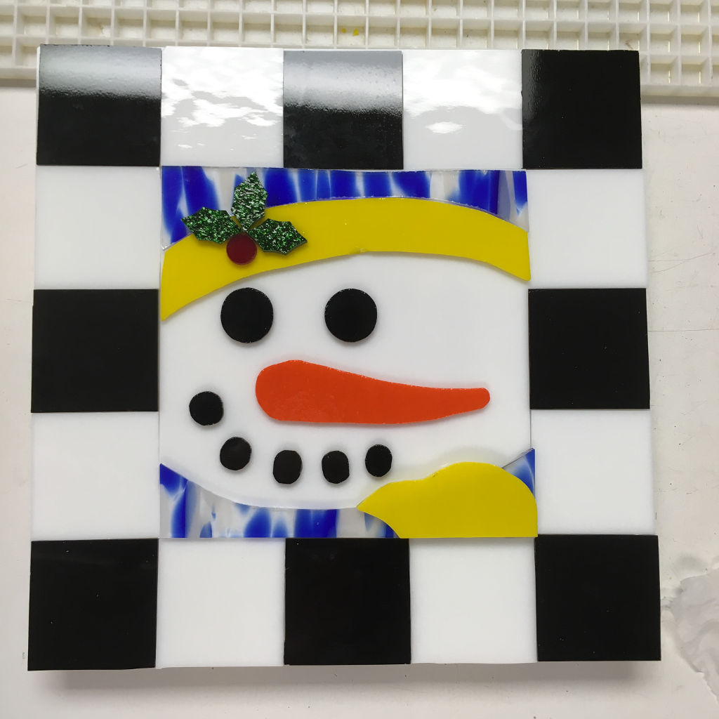 Student designed fused snowman cookie tray before firing